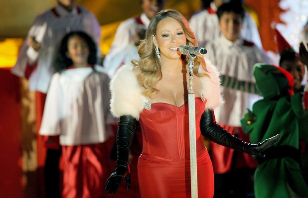 Mariah Carey performing live at 2013 Rockefeller Center Christmas Tree Lighting at Rockefeller Center Plaza in New York