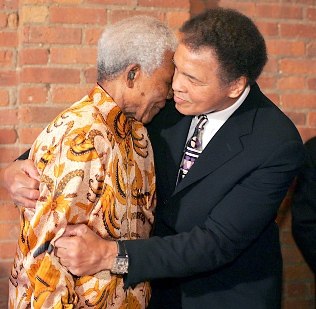 Nelson Mandela with Muhammad Ali at a dinner to mark the 15th anniversary of Mandela's release from prison, May 2005, New York City.