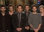 The Anchorman 2: The Legend Continues star shares SNL stage with boyband.