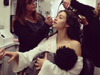 Emmy Rossum spoofs Gisele Bündchen breastfeeding photo