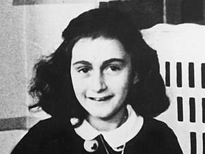 Anne Frank writing in her diary