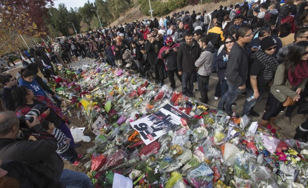 Fans crowd round during a memorial rally for Paul Walker