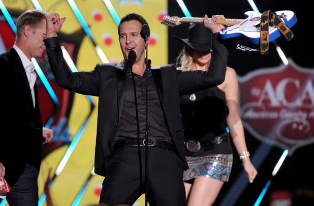 Luke Bryan accepts the artist of the year award during the American Country Awards 2013
