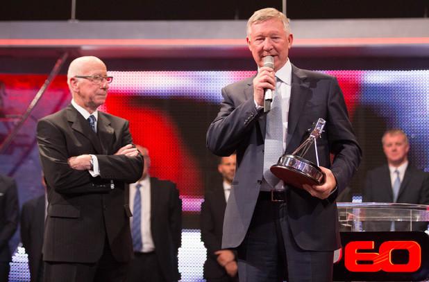 Sir Bobby Charlton presents Sir Alex Ferguson with the Sports Personality Of The Year Diamond Award