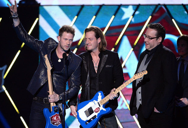 Florida Georgia Line accept the Single of the Year award during the American Country Awards 2013