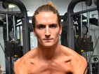 Oliver Proudlock poses on various pieces of gym equipment to promote new book.