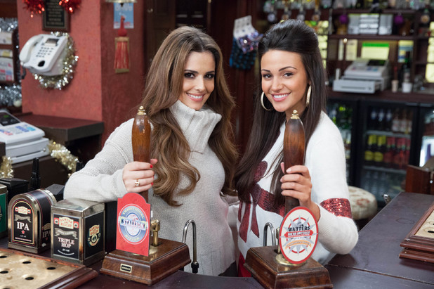 Text Santa: Cheryl Cole and Michelle Keegan behind the Rovers Return bar for Coronation Street's contribution to fundraiser