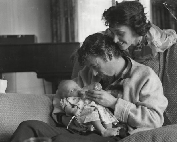 Peter O'Toole feeds his baby daughter Kate in 1960