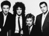 John Deacon, Brian May, Roger Taylor and Freddie Mercury of Queen