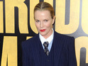 Kim Basinger dresses in gangster-style suit at Grudge Match premiere.