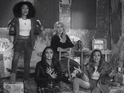 The group perform their new track in a derelict building in the clip.