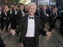 Oscars host dons a tuxedo and dances in director Paul Feig's promo.