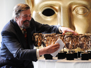 Stephen Fry polishes BAFTA masks - February 4, 2013