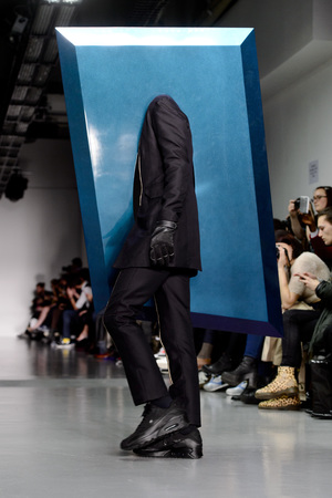 A model on the catwalk at the Kay Kwok fashion show, held at the Victoria House as part of London Collections: Men AW14.