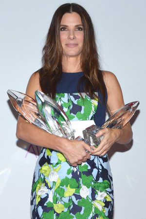 Sandra Bullock, winner of the Favorite Movie Actress, Favorite Dramatic Movie Actress and Favorite Comedic Movie Actress at the People's Choice Awards 2014