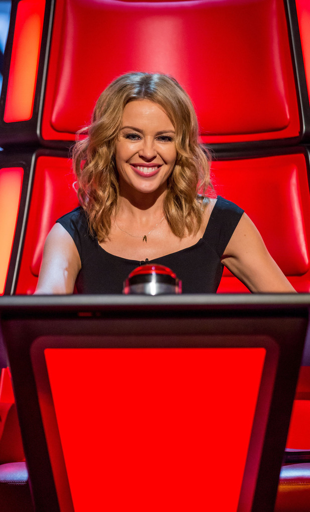 Kylie Minogue sits in her red chair on The Voice UK