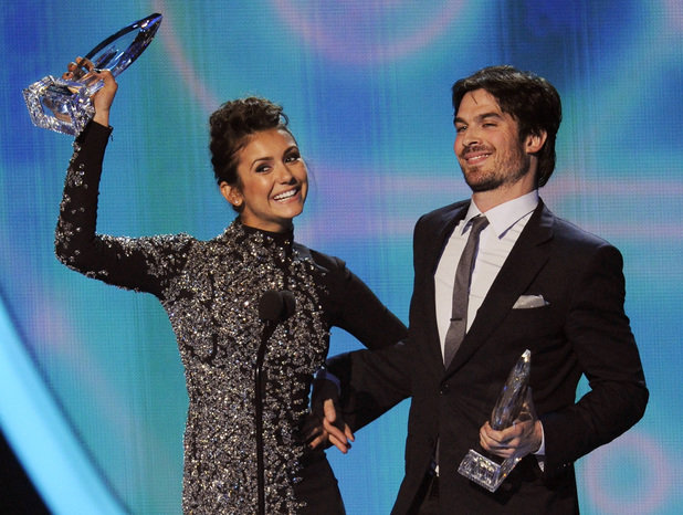 "Nina Dobrev, left, and Ian Somerhalder accept the award for favorite on-screen chemistry for ""The Vampire Diaries"" at the 40th annual People's Choice Awards"