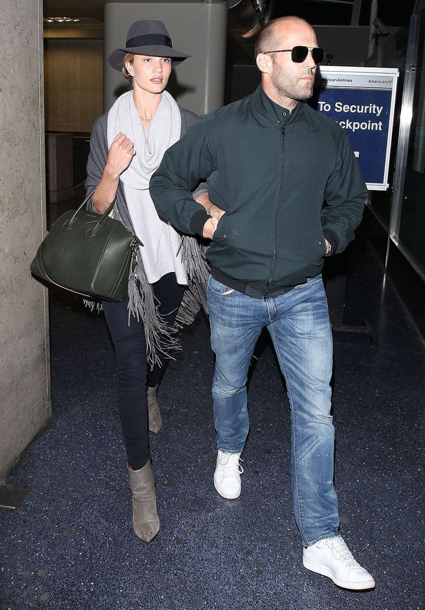 Rosie Huntington-Whiteley and Jason Statham arriving at LAX airport, Los Angeles