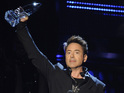 Robert Downey Jr. accepts the award for favorite action movie star at the 40th annual People's Choice Awards