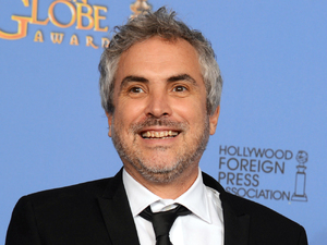 Alfonso Cuarón with a Golden Globe award