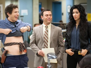 Andy Samberg as Detective Jake Peralta, Joe Lo Truglio as Detective Charles Boyle & Stephanie Beatriz as Detective Rosa Diaz in Brooklyn Nine-Nine