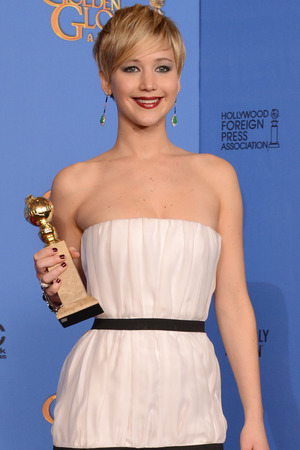 Jennifer Lawrence with a Golden Globe award
