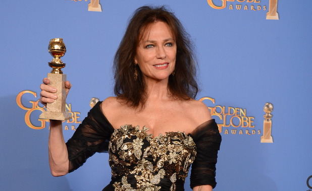 Jacqueline Bisset with a Golden Globe award
