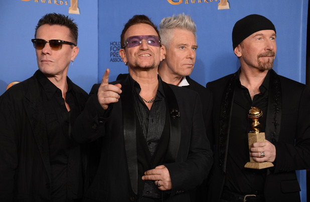 U2 with a Golden Globe award