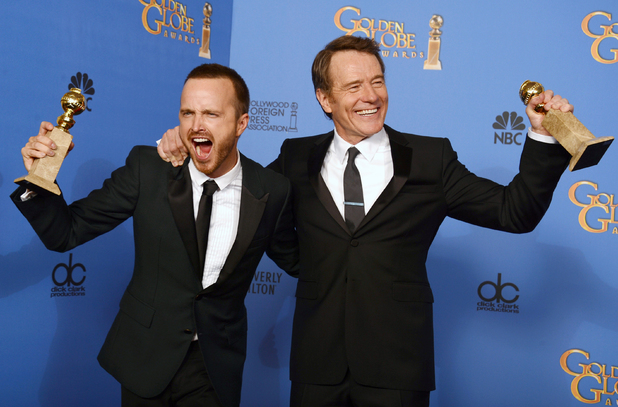 "Bryan Cranston and Aaron Paul pose in the press room with the award for best television series - drama for ""Breaking Bad"" at the 71st annual Golden Globe Awards"