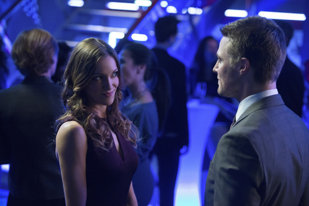 Katie Cassidy as Laurel Lance and Stephen Amell as Oliver Queen in 'Arrow' S02E10: 'Blast Radius'