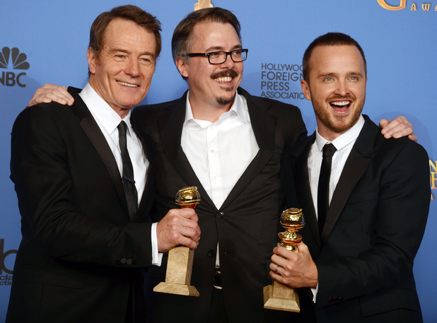 "Bryan Cranston, from left, Vince Gilligan, and Aaron Paul pose in the press room with the award for best television series - drama for ""Breaking Bad"" at the 71st annual Golden Globe Awards"