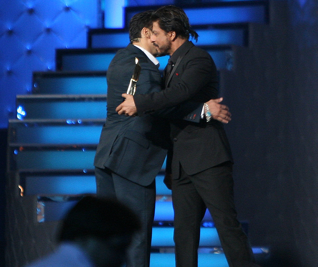 Bollywood actor Salman Khan hugs the 'Best Entertainer of the year Award Winner', Shah Rukh Khan at Star Guild Awards in Mumbai