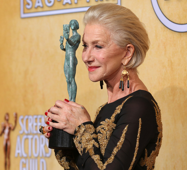 Helen Mirren poses in the press room with the award for outstanding performance by a female actor in a television movie or miniseries for Phil Spector