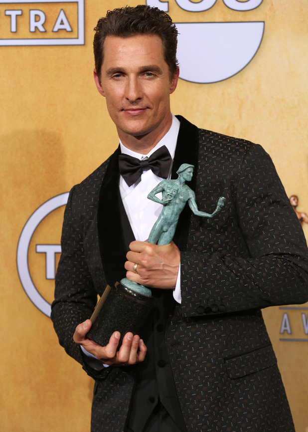 Matthew McConaughey poses in the press room with the award for outstanding performance by a male actor in a leading role for Dallas Buyers
