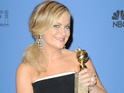 Parks and Recreation star kisses U2 frontman as she wins Best Comedy Actress.