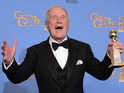 Jerry Weintraub with a Golden Globe award