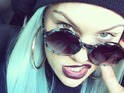 Singer sports bright blue tresses in photos shared on her Instagram page.