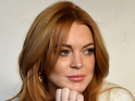 Lindsay Lohan poses with sober coach Michael Cormier in a new picture.