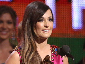 Kacey Musgraves accepts the award for best country album at the 56th annual GRAMMY Awards