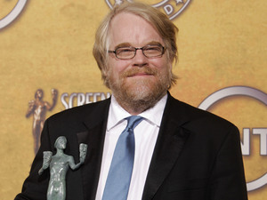 "Philip Seymour Hoffman poses with the award for outstanding performance by a male actor in a leading role for his work in ""Capote,"" at the 12th Annual Screen Actors Guild Awards on Sunday, Jan. 29, 2006, in Los Angeles."