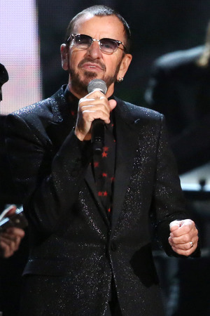Ringo Starr performs on stage at the 56th annual Grammy Awards