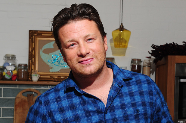 Jamie Oliver poses in a kitchen in London, ahead of the publication of his new book Save With Jamie