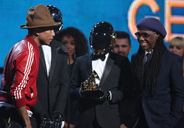 Pharrell Williams, from left, Daft Punk and Nile Rodgers accept the award for best pop duo/group performance at the 56th annual Grammy Awards