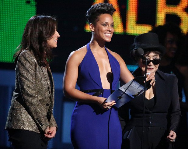 Olivia Harrison, from left, Alicia Keys and Yoko Ono speak on stage at the 56th annual Grammy Awards