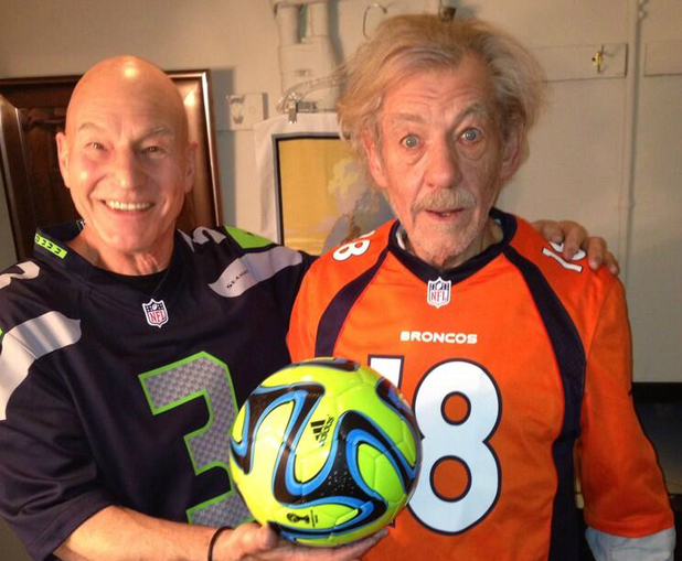 Patrick Stewart and Sir Ian McKellen pose in 'football' jerseys with a 'football' ahead of the Superbowl.