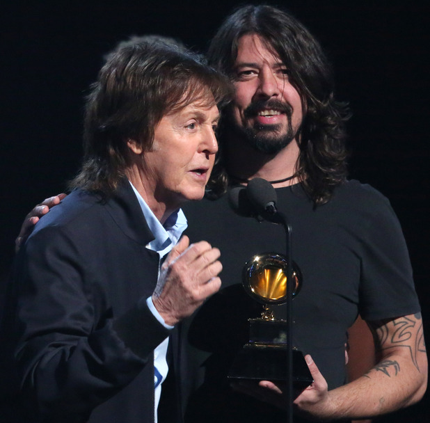 "Paul McCartney, left, and Dave Grohl, accept the award for best rock song for '""Cut Me Some Slack' at the 56th annual Grammy Awards"