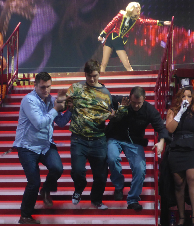A man invades the stage during Taylor Swift's UK tour