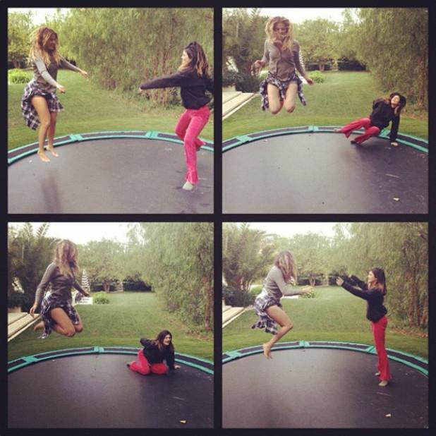 Khloe Kardashian and Kylie Jenner trampolining