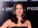 How does Olivia Munn get into her Psylocke outfit? Plenty of KY Jelly.
