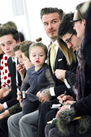 David Beckham with his children at the Victoria Beckham catwalk show, part of New York Fashion Week